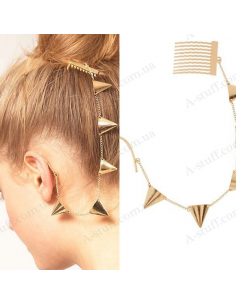 Cuff in the ear with a hair comb